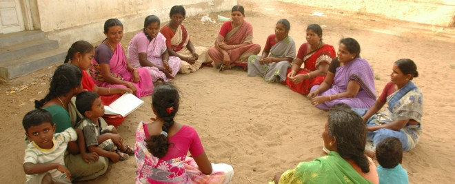 A group of women gather for a self help group meeting