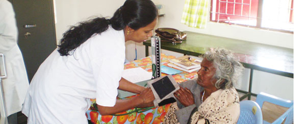 A SCAD nurse treating an elderly patient in Tamil Nadu