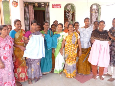 Ladies from a Women's savings group at SCADCharity train for a new income generating activity in sowing